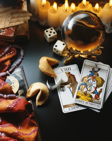 Tarot cards, fortune cookies, palmistry, and crystal ball